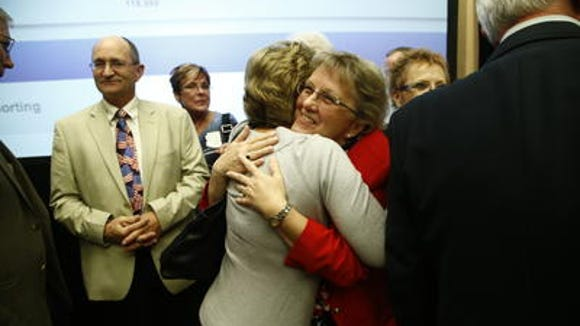 Diane Douglas hugs a supporter on election night.