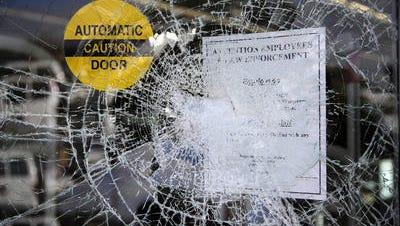 Shattered store window in Ferguson, Mo.
