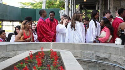 The last graduating class of Blessed Sacrament-St. Gabriel High School celebrate their commencement, May 30, 2013 in New Rochelle. The private Catholic school closed in June of that year.