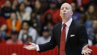 Cincinnati Bearcats head coach Mick Cronin instructs the team in the first half.
