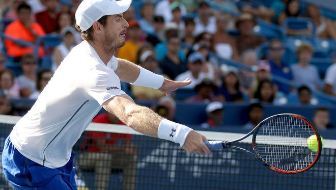 Andy Murray reaches to return a shot to Marin Cilic in the final of the Western and Southern Open at the Lindner Family Tennis Center in Mason Sunday, August 21, 2016.
