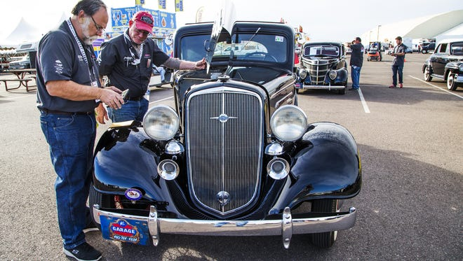 Dave Kirk, left, and Ken Koch, official drivers for Barrett-Jackson Collector Car Auctions, inspect a 1935 Chevrolet 3-Window Coupe upon check-in at WestWorld of Scottsdale , Thursday, January 12, 2017.