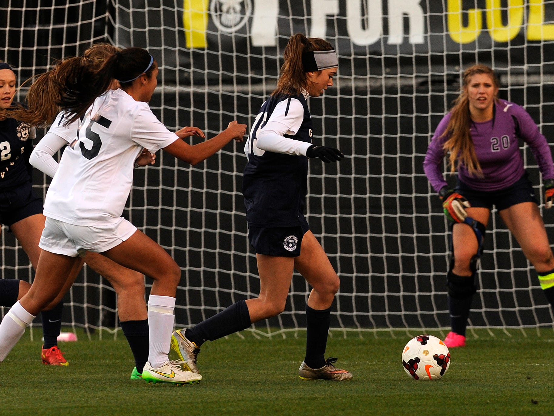 Granville junior defender Reilly Welles steals the ball from Akron Hoban forward Jessica Wong as goalkeeper Tori Long stands ready in the net. The Blue Aces fell 2-1 to Akron Hoban in overtime in the state final on Friday, Nov. 13, 2015, at Mapfre Stadium in Columbus.