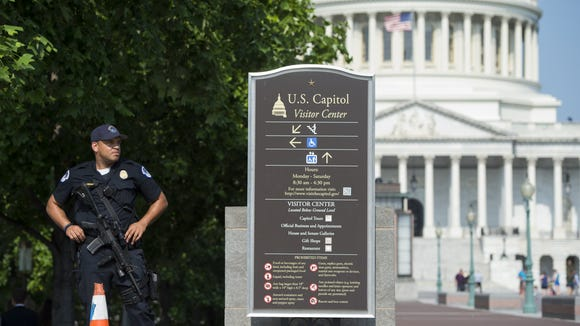 SAUL LOEB, AFP/Getty Images A Capitol Police officer stands guard Wednesday after the attack on members of Congress in nearby Virginia.