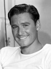 Studio portrait of Errol Flynn in 1940. Flynn, who was known for his good looks and heroic screen roles, at that time was Warner Bros. top star.