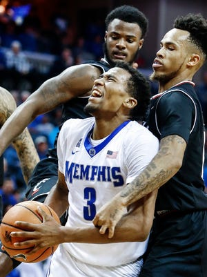 Memphis guard Jeremiah Martin drives the lane against the Cincinnati defense during second half action at the FedExForum in Memphis Tenn., Saturday, January 27, 2018.