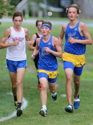 East Canton's Alex Yarian (center) and Gabe Shilling (right) — in action during the school's own invitational, Sept. 2, 2020 — each finished in the top 10 Saturday at Boardman to lead the Hornets to a Division III regional championship.
