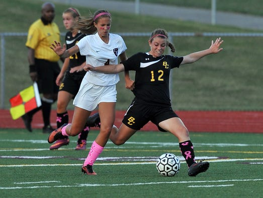 Bloom-Carroll's Ellyse McKenzie, right, fights with Canal Winchester's Hillary Counts for control of the ball during Tuesday night's game, Aug. 19, 2014, at Canal Winchester High School in Canal Winchester. Canal Winchester won the match 2-0.