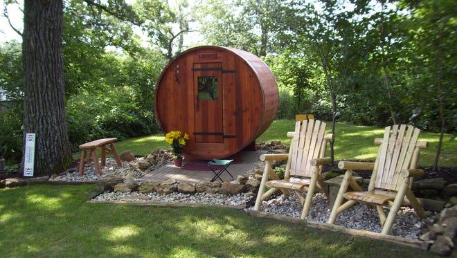 One of RW Saunas custom-made barrel saunas in a backyard.