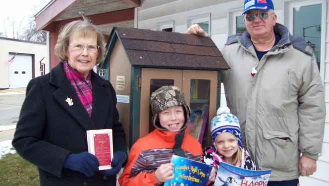 Fox Lake Public Library has installed a Free Littel Library in memory of Brenda Rabehl, Fox Lake Public Library assistant from 1994 to 2004. Pictured are, next to the Little Free Library, from left, are Library Director Paula Torgeson, James and Kayleigh Hermes of Fox Lake, and Richard Linke of Pardeeville.