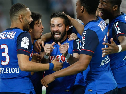 Monaco's Joao Moutinho celebrates with teammates after scoring against Marseille, during the League One soccer match between Marseille and Monaco, at the Velodrome Stadium, in Marseille, southern France, Sunday, May 10, 2015. (AP Photo/Claude Paris)