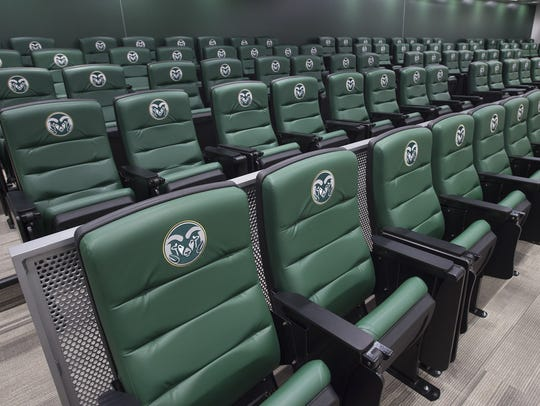 The team meeting room is lined with chairs to seat