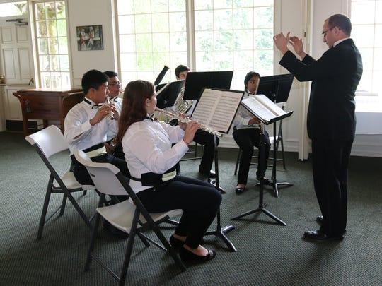 Brett Randolph conducts a wind ensemble from Waldo