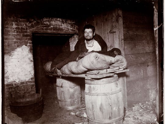 "This photo taken by Jacob A. Riis, titled, ""Peddler Who Slept in the Cellar of 11 Ludlow Street, 1892,"" will be included in the exhibit opening April 7 at the Hayes Center."