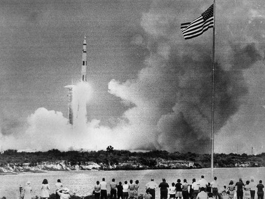 The huge Saturn rocket carrying the Apollo 13 spacecraft