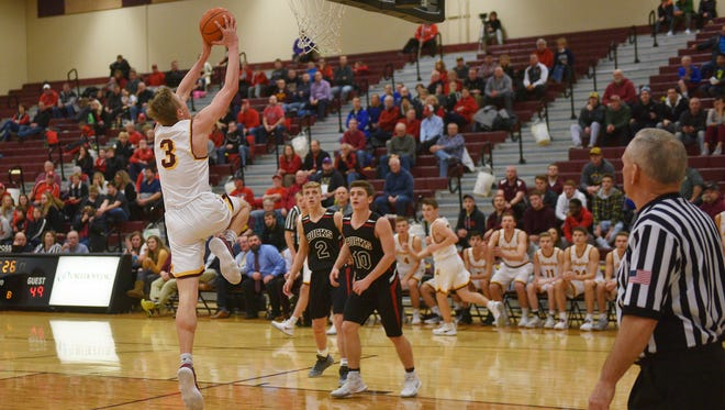 Harrisburg's Chase Altenburg dunks against Yankton during the game Thursday, Jan. 4, at Harrisburg.