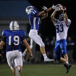 Simon Kenton's senior defensive back Jacob Harney, left, breaks up a pass during an early season game against Highlands.