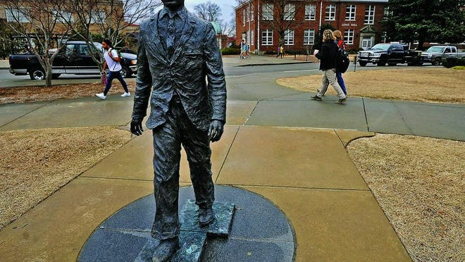 The James Meredith statue is seen on the University of Mississippi campus in Oxford Monday. A $25,000 reward was offered for information leading to the arrest of those involved in sullying the statue early Sunday.