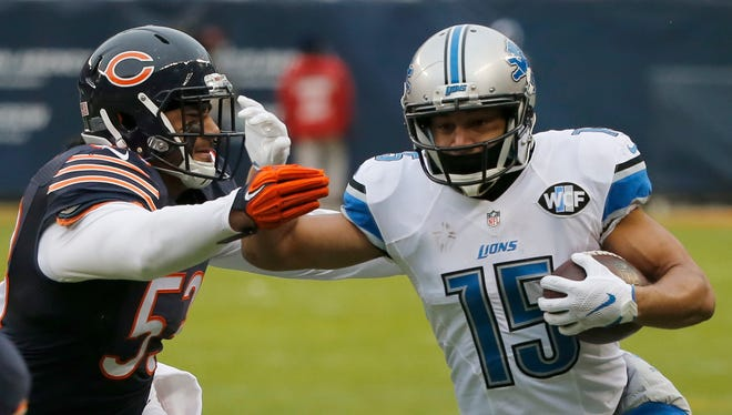 Detroit Lions wide receiver Lance Moore (16) runs against Chicago Bears linebacker John Timu (53) during the first half of an NFL football game, Sunday, Jan. 3, 2016, in Chicago.