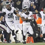 Eagles' linebacker Bryan Braman, left, escorts running back Darren Sproles to a punt return TD in the third quarter to put the team up 28-14 on the Patriots in Sunday's 35-28 win.