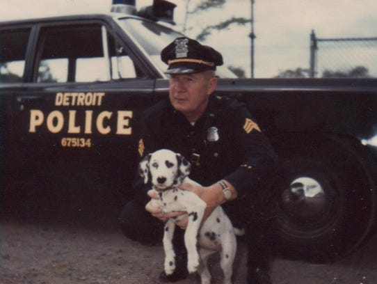 Detroit Sgt. William Woltemate poses with his dog,