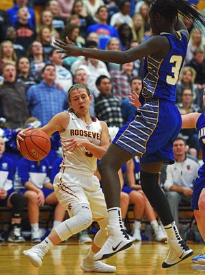 Roosevelt's Taylor Bonestroo (5) tries to get around O'Gorman's Sebastian Akoi (35) during a game Friday, Dec. 9, 2016, at Roosevelt High School in Sioux Falls.
