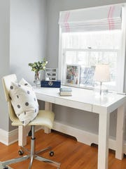 The study area in the bedroom is the perfect spot for the young girl to complete her homework.
