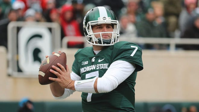Tyler O'Connor of the Michigan State Spartans drops back to pass during the first quarter against the Ohio State Buckeyes at Spartan Stadium on Nov. 19, 2016 in East Lansing.