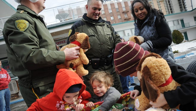 Members of the Washoe County Sheriff's Department look on as children pick out stuffed animals during the 2010 Christmas on the Corridor. The program is sponsored by the Reno Sparks Corridor Business Association and the Washoe County Sheriff's Office.