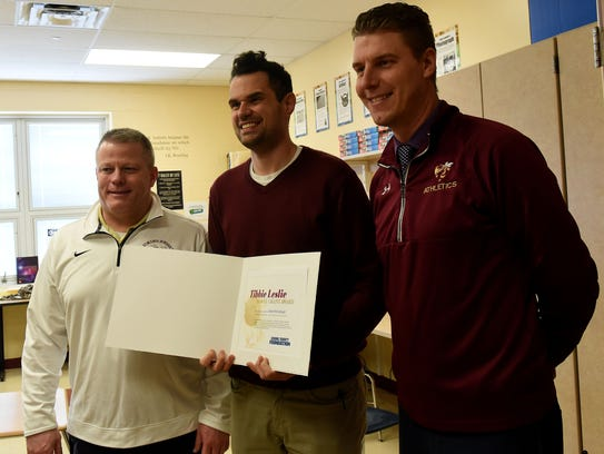 Licking Heights teacher Sean McCullough (center) with