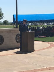 Lt. Col. Michael Hanson, commander of the Dyess Air Force Base 7th Equipment Maintenance Squadron, delivers the keynote address during the annual Memorial Day ceremony at Texas State Veterans Cemetery at Abilene.