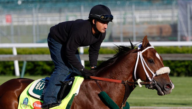 Apr 27, 2015; Louisville, KY, USA; Mr. Z ridden by Edvin Vargas and trained by D. Wayne Lukas is exercised during morning work outs at Churchill Downs. Mandatory Credit: Mark Zerof-USA TODAY Sports