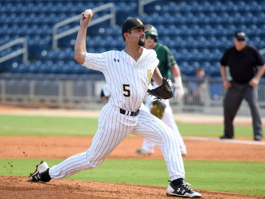 Southern Miss pitcher Nick Sandlin throws the ball