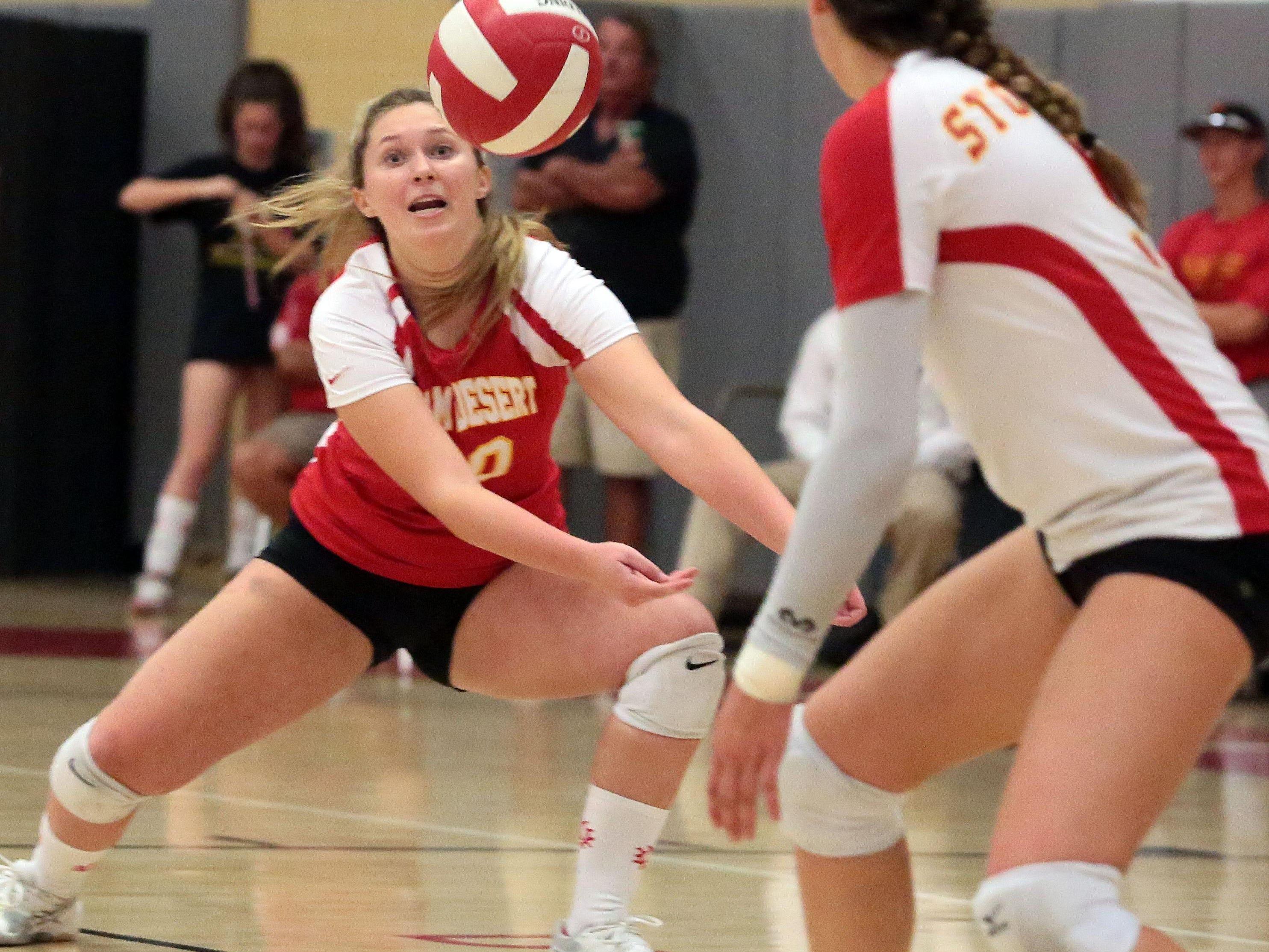 Palm Desert Kacey Johnson digs against Palm Springs on Thursday in Palm Desert.