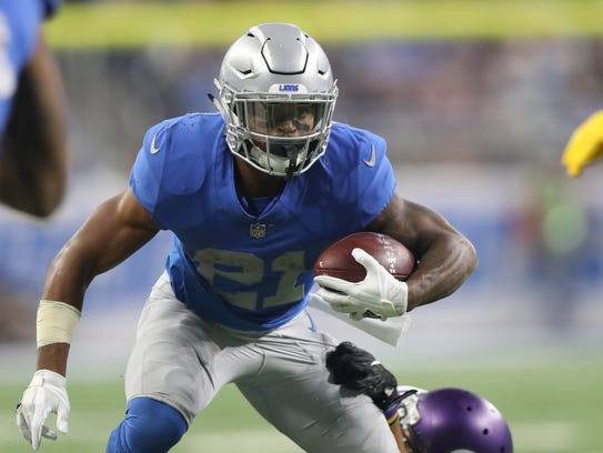 Ameer Abdullah is tackled by Vikings linebacker Anthony Barr in the third quarter