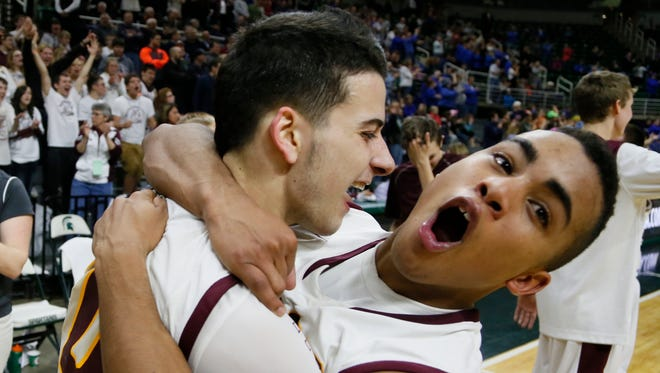 Morenci's Alex Thomas, left, and Austin Sandusky after their 53-52 win over Waterford Our Lady in the MHSAA Boys Class D semi final basketball game on Thursday, March 26, 2015 in East Lansing.