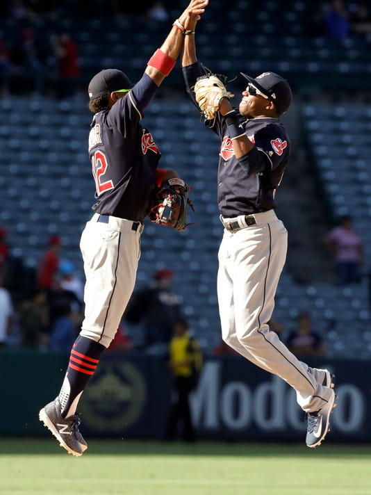 Cleveland Indians shortstop Francisco Lindor, left, celebrates with center fielder Greg Allen after the teams win against the Los Angeles Angels during a baseball game in Anaheim, Calif., Thursday, Sept. 21, 2017. (AP Photo/Chris Carlson)