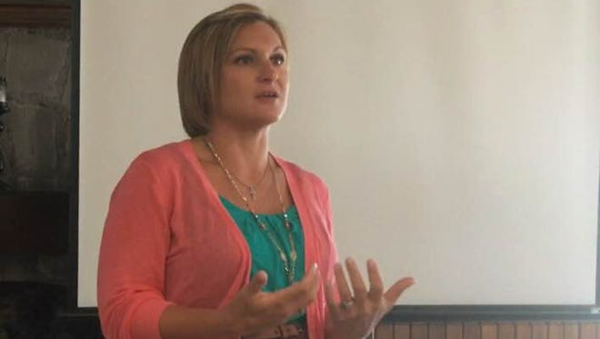 Former heroin addict Laci Giboney shares her story during the Indiana Youth Institute's Youth Worker Cafe on teens and heroin June 21, 2016, in Winchester.