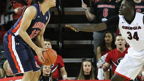 Auburn Tigers forward Tyler Harris (12) looks to shoot