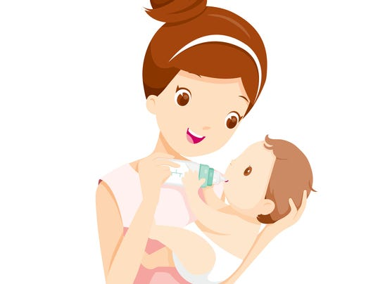 Mother Feeding Baby With Milk In Baby Bottle