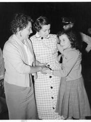Pierette meeting her mother Vivian after surviving the journey to America with her grandmother Domenica (left).