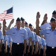"Airmen lift their right hand as they repeat the oath of enlistment at the Air Force Basic Training graduation ceremony, Lackland Air Force Base, Texas. The Air Force has withdrawn a requirement that all airmen who take the oath of enlistment and officer appointment conclude with  ""so help me God,"" the service announced Wednesday."