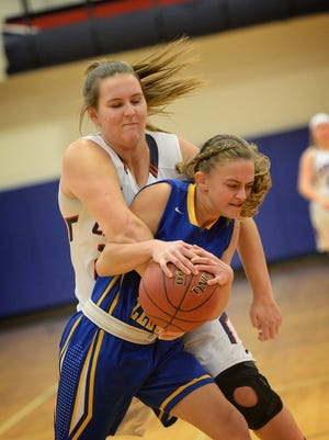 Lebanon's Mikayla Bowman, left, and Northern Lebanon's Lindsay McFeaters wrestle over a loose ball during the Lady Vikings' 51-15 victory Wednesday evening, Dec. 27 at LHS..