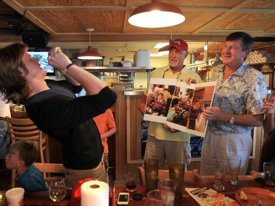 Craig Sager Jr., left, snaps a photo of friends Don
