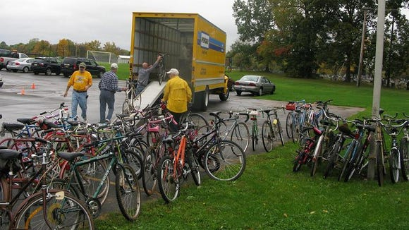 Cars kept dropping off bicycles at the Penfield Community Bike Drop-Off site.
