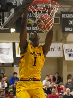 Harry Giles of High Point (N.C.) Wesleyan Christian delivers one of his seven dunks Tuesday night.