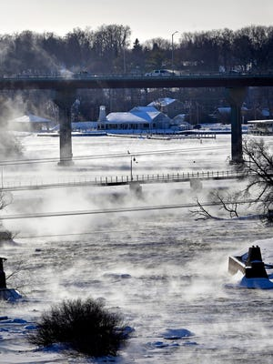 Steam rises off the Fox River near the Oneida Skyline Bridge in the bitter cold. Roy Eckberg, a meteorologist with the National Weather Service office in Green Bay, says this might go down as the second-coldest winter on record in Appleton.