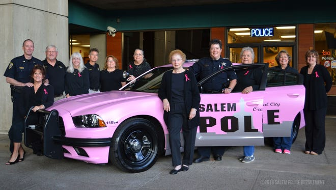 Salem Police Department a pink-wrapped police cruiser in honor of Breast Cancer Awareness Month on Friday, Sept. 30.