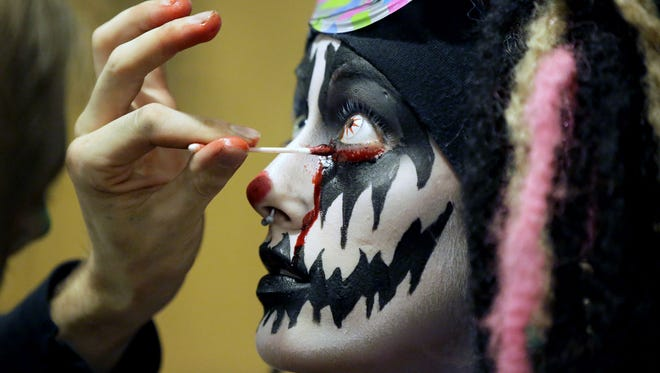 Scared yet? Tink Joas has makeup applied as part of her work at the Burial Chamber haunted house in Neenah.