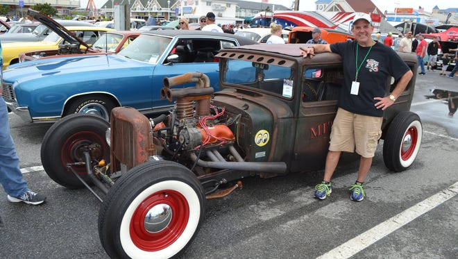 Steve Mitchell of Perry Hall, Maryland, poses with his modified 1938 Dodge at Cruisin' Ocean City.